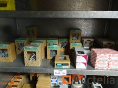 35 boxes, wood screws, tirefonds, staples Bosch, adjusting screw